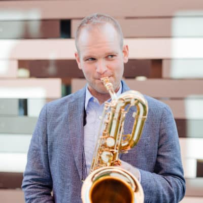 Photo of musician Ryan Middagh playing his saxophone